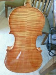 first violin made varnish being applied