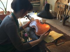 Violin being inspected at 'Masion du Violon' in Montreal